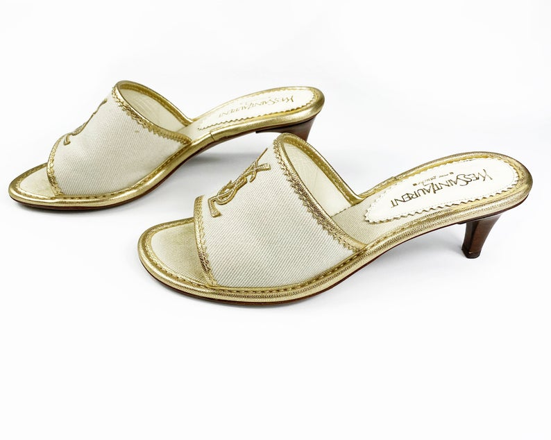 FRUIT Vintage Yves Saint Laurent logo canvas mules with gold leather trim. Features a a large gold leather YSL logo at front and stacked wooden heels.