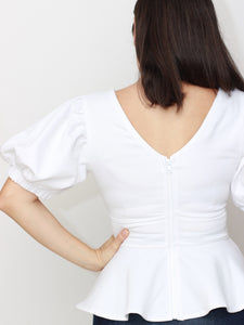women's peplum top with puff sleeve in white