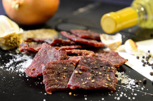 1933 Peppered beef jerky, Made in USA Bakersfield, CA Award winning jerky, image of peppered jerky with ingredients made in USA