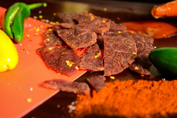 1933 Red Hot Beef Jerky image with ingredients, made in USA original secret jerky recipe, best hot beef jerky