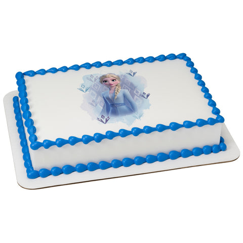 Edible image of Elsa from Disney's Frozen on a cake.