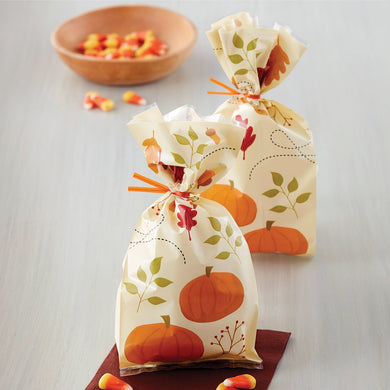 These poly treat bags feature a fall pattern with pumpkins, leaves, branches, and acorns.