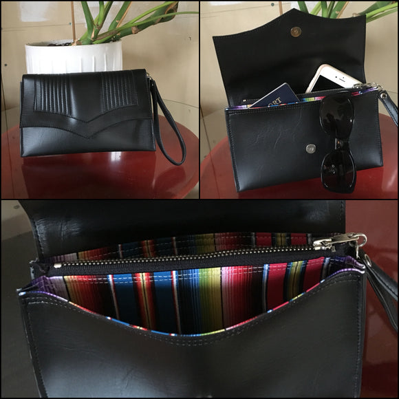 Clutch Bag with mercury pleated black onyx vinyl and fiesta print lining with inside zipper pocket with two expanding open pockets, magnetic snap closure, and signature Trophy Queen label inside, turns from wrist zipper pull strap into a long strap shoulder bag.