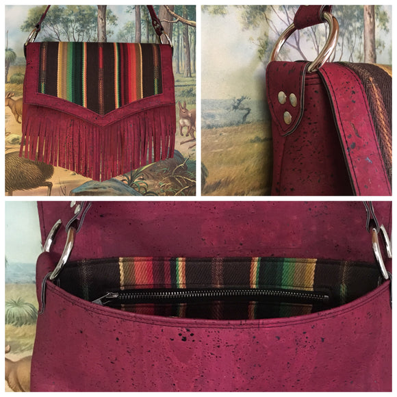 "Fringe Saddle Bag in Genuine Sustainable Wine Colored Cork with Chocolate Serape Fabric with 24"" (61cm) shoulder strap, magnetic closure, inside open divided pocket and zipper pocket with J.T. Christensen Designs Signature Label and hidden serial number. Ships from Sweden"