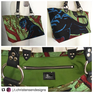 "Limited Edition Panther Open Tote with Olive Green Cotton Lining measuring 17"" Across At Bottom (21.5"" Across At Top) x 10.5"" Tall x 5"" Wide (43 cm At Bottom / 54.5 cm At Top x 26.5 cm Tall x 12.5 cm Wide) with 20"" (51cm) vinyl tote straps. Inside an open divided pocket with signature J.T. Christensen Label and zipper pocket with hidden serial number. Ships from Sweden."