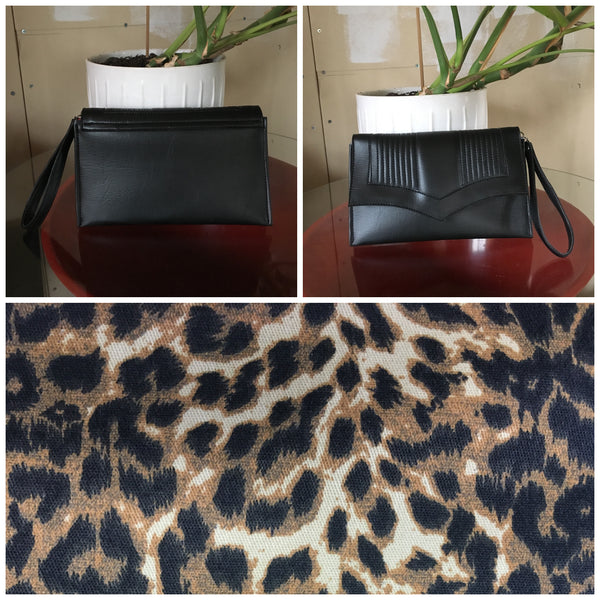 Clutch Bag with mercury pleated pebble black vinyl and leopard print lining with inside zipper pocket with two expanding open pockets, magnetic snap closure, and signature Trophy Queen label inside, turns from wrist zipper pull strap into a long strap shoulder bag.