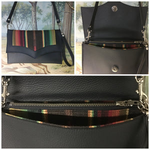 Clutch Bag in chocolate brown serape with pebble black and matching chocolate serape lining with inside zipper pocket with two expanding open pockets, magnetic snap closure, and signature Trophy Queen label inside, turns from wrist zipper pull strap into a long strap shoulder bag.