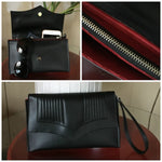 Clutch Bag With Mercury Style Pleating - Onyx Black / Sangria Red Lining
