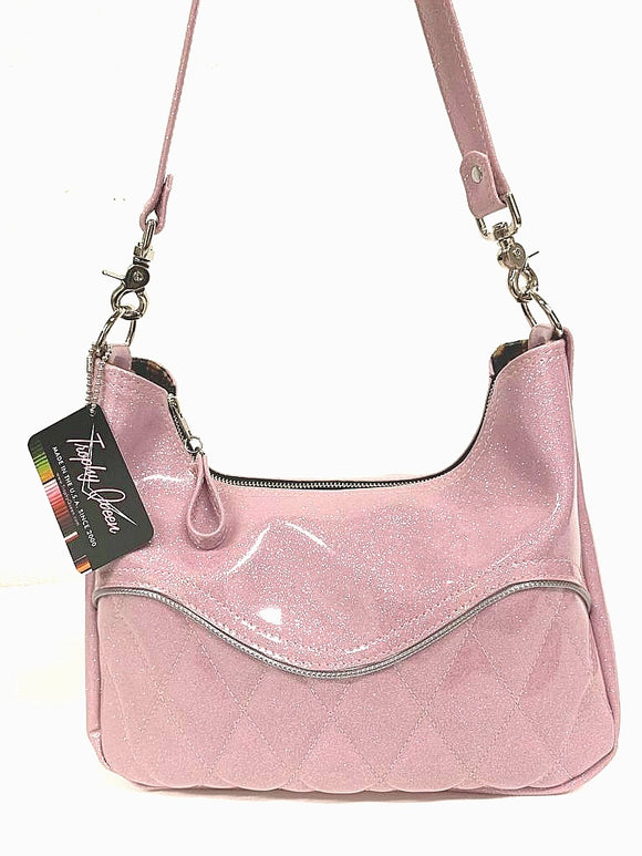 "Diamond pleat El Dorado hobo bag in blush pink glitter vinyl and lined with plush leopard handcrafted in California. Medium size featuring 26"" shoulder strap, insize open divided pocket and inside zipper pocket. Signature Trophy Queen label inside and hidden serial number."