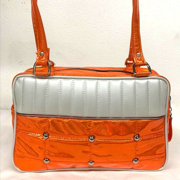 "Lincoln Tote in Limited Edition Cosmic Orange and Pearl White Vinyl with Plush Leopard Lining. Made matching vinyl zipper pull, nickel feet, inside zipper pocket with serial number and open divided pocket with signature Trophy Queen label. The straps are approximately 25"" and come with an extra set of replacement straps. Locally made and ships from California"