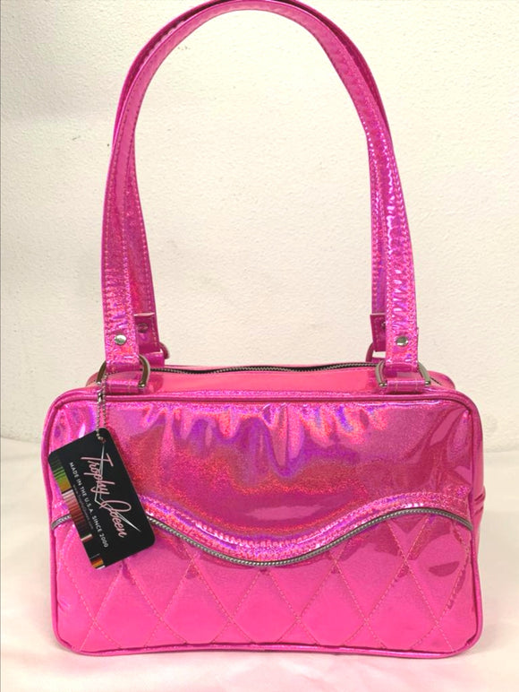 "Limited Edition Color the Diamond Pleat Tuck and Roll Tote in Cosmic Pink Glitter Vinyl and plush leopard lining is handcrafted in California with nickel hardware and 25"" straps plus it comes with replacement straps. Inside open divided pocket and inside zipper pocket with serial number hidden inside. Nickel feet, vinyl zipper pull, and signature Trophy Queen Label included. The perfect size bag for any trip!"