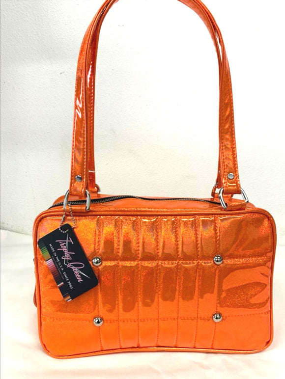 "Galaxy Shoulder Tote, slightly larger than the Galaxy Shoulder Bag in Limited Edition Cosmic Orange  Glitter Vinyl and Plush Leopard Lining with nickel hardware and nickel feet, vinyl zipper pull, and 25"" (61cm) straps. Inside you'll find an open divided pocket, a zipper pocket with serial number inside and signature Trophy Queen Label. Ships from California with an extra set of replacement straps."