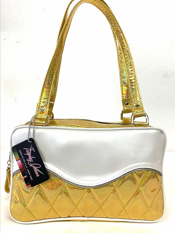 "Limited Edition Color the Diamond Pleat Tuck and Roll Tote in Cosmic Gold Glitter and Pearl White Vinyl with plush leopard lining is handcrafted in California with nickel hardware and 25"" straps plus it comes with replacement straps. Inside open divided pocket and inside zipper pocket with serial number hidden inside. Nickel feet, vinyl zipper pull, and signature Trophy Queen Label included. The perfect size bag for any trip!"