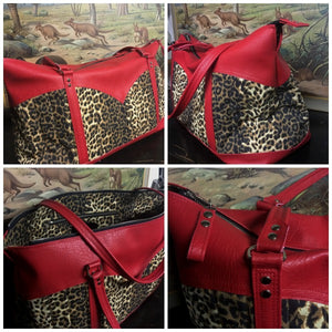 "Sample Sale Get Away Weekender Bag in Leopard and Bombshell Red with Leopard Lining in ""almost perfect condition"" and sold ""as is"". Measures 20"" x 9"" x 13"" (approx 50cm x 22cm x 33cm) with 32"" (approx 81cm) Shoulder Straps. Inside is an open divided pocket and zipper pocket. Fits most Airline overhead compartments. All Sales are final, no returns and no exchanges. Price includes shipping from Sweden."