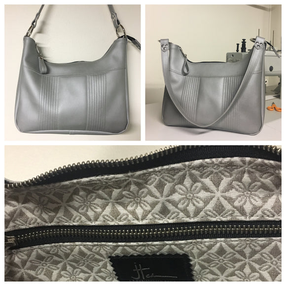 Hobo Shoulder Bag with Mercury Pleating in Silver Vinyl with Snowflake Print Lining measuring Approx. Measures 12