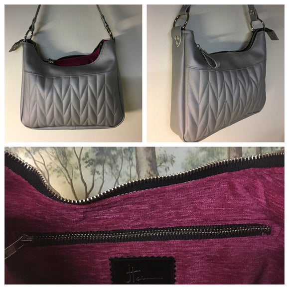 Hobo Shoulder Bag with Firebird Pleating in Silver Vinyl with Magenta Chenille Lining measuring Approx. Measures 12