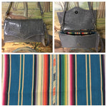 Clutch Bag in mercury pleated steel gray glitter and teal serape lining with inside zipper pocket with two expanding open pockets, magnetic snap closure, and signature Trophy Queen label inside, turns from wrist zipper pull strap into a long strap shoulder bag.