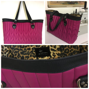 "Open Tote with Firebird Style Pleating in Limited Edition Wild Berry Fabric and Pebble Black Vinyl with Plush Leopard Print Lining. Measuring 15"" across bottom (19"" across top) x 10"" x 5"" (38 cm At Bottom / 48.25 cm At Top x 25.5 cm Tall x 12.5 cm Wide) and 24"" (61cm) Straps. An open divided pocket and zipper pocket with hidden serial number and signature J.T. Christensen Label."