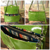 Clutch Bag in lime green glitter vinyl with serape print lining with inside zipper pocket with two expanding open pockets, magnetic snap closure, and signature Trophy Queen label inside, turns from wrist zipper pull strap into a long strap shoulder bag.