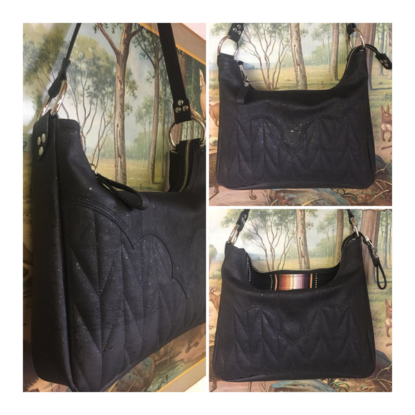 "Death Valley hobo shoulder bag in genuine black cork from Portugal and black serape print lining with zipper closure and vinyl pull, inside open divided pocket and one zipper pocket with 22"" shoulder strap. Signature J.T.Christensen Designs Label inside."