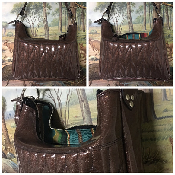 Hobo Shoulder Bag with Firebird Pleating in Root Beer Brown Glitter Vinyl and Genuine Turquoise Serape Print Lining measuring Approx. Measures 12