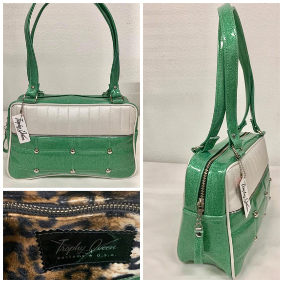 "Lincoln Tote in Seafoam Green Glitter and Pearl White Vinyl with Plush Leopard Lining. Matching vinyl zipper pull, nickel feet, inside zipper pocket with serial number and open divided pocket with signature Trophy Queen label. The straps are approximately 25"" and come with an extra set of replacement straps. Locally made and ships from California"