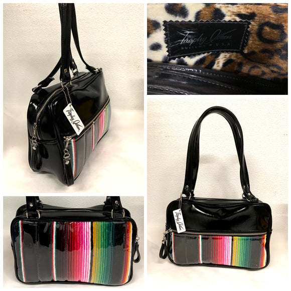 "Fairlane Tote Bag in Genuine Mexican Blanket with Clear Overlay and Grease Black Vinyl with plush Leopard Lining. This purse has matching vinyl zipper pull, nickel feet, inside zipper pocket with serial number and open divided pocket with signature Trophy Queen label. The straps are approximately 25"" and come with an extra set of replacement straps. Locally made and ships from California."