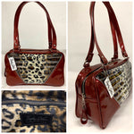 Comet Tote in red glitter vinyl with plush leopard lining handcrafted in California with nickel hardware, an extra set of straps, vinyl zipper pull, inside open divided pocket, zipper pocket with serial number inside and signature Trophy Queen label.