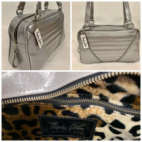 Comet Tote in chrome glitter vinyl with plush leopard lining handcrafted in California with nickel hardware, an extra set of straps, vinyl zipper pull, inside open divided pocket, zipper pocket with serial number inside and signature Trophy Queen label.