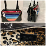 Comet Tote in Mexican blanket with clear overlay and grease black vinyl with plush leopard lining handcrafted in California with nickel hardware, an extra set of straps, vinyl zipper pull, inside open divided pocket, zipper pocket with serial number inside and signature Trophy Queen label.