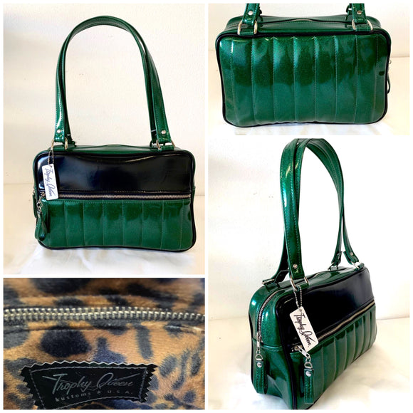 "Fairlane Tote Bag in Green Glitter Vinyl and Grease Black Vinyl with plush Leopard Lining. This purse has matching vinyl zipper pull, nickel feet, inside zipper pocket with serial number and open divided pocket with signature Trophy Queen label. The straps are approximately 25"" and come with an extra set of replacement straps. Locally made and ships from California."