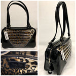 Comet Tote in grease black vinyl and plush leopard with clear overlay with plush leopard lining handcrafted in California with nickel hardware, an extra set of straps, vinyl zipper pull, inside open divided pocket, zipper pocket with serial number inside and signature Trophy Queen label.