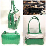 "Fairlane Tote Bag in Seafoam Green Glitter and Pearl White Vinyl with plush Leopard Lining. This purse has matching vinyl zipper pull, nickel feet, inside zipper pocket with serial number and open divided pocket with signature Trophy Queen label. The straps are approximately 25"" and come with an extra set of replacement straps. Locally made and ships from California."