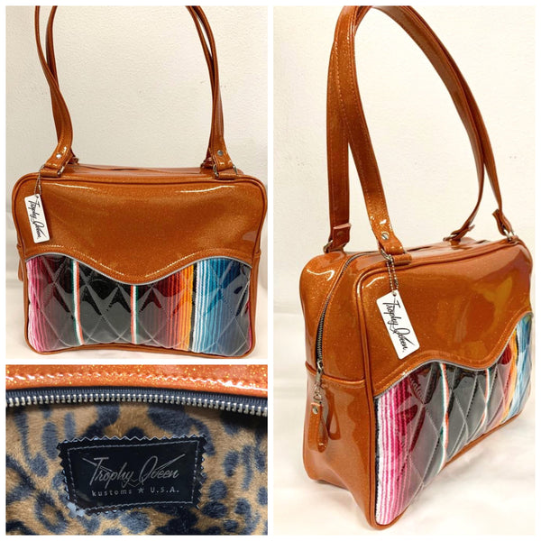"Diamond Pleat Tuck and Roll Business Bag comes in Tangerine Glitter Vinyl and Mexican Blanket with plush leopard lining, 29"" straps with nickel hardware and comes with extra replacement straps! Inside has an open divided pocket and zipper pocket with hidden serial number. Tote comes with vinyl zipper pull, nickel fee and signature Trophy Queen label. Made with love in California."
