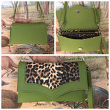Clutch Bag in tiki green vinyl and leopard with leopard lining with inside zipper pocket with two expanding open pockets, magnetic snap closure, and signature Trophy Queen label inside, turns from wrist zipper pull strap into a long strap shoulder bag.