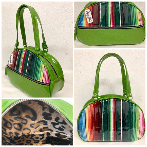 Lucky Strike Bowling Style Bag made with Lime Green Glitter and Mexican Blanket with Clear Overly Vinyl and lined with Plush Leopard inside with front zipper pocket, shoulder straps with extra set included inside has divided pocket, zipper pocket with hidden serial number inside and signature trophy queen label.