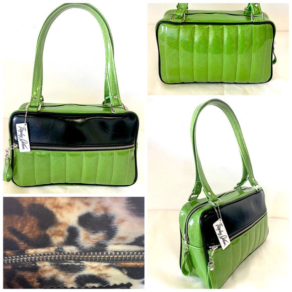 "Fairlane Tote Bag in Lime Green Glitter Vinyl and Grease Black Vinyl with plush Leopard Lining. This purse has matching vinyl zipper pull, nickel feet, inside zipper pocket with serial number and open divided pocket with signature Trophy Queen label. The straps are approximately 25"" and come with an extra set of replacement straps. Locally made and ships from California."