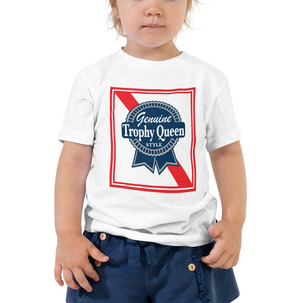 Let your toddler do their thing while feeling super comfy and looking extra stylish in this short-sleeve jersey t-shirt made from pre-shrunk, 100% cotton with a unique print of the Trophy Queen Blue Ribbon Logo. The tee is soft, durable, relaxed fit for extra comfort, and bound to become the staple of your toddlers wardrobe.