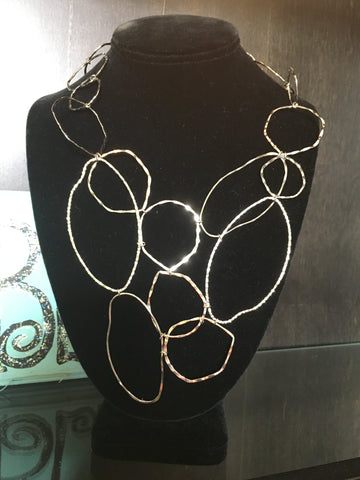 Silver tone loop necklace