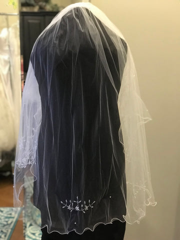 Double tier white finger tip length wedding veil