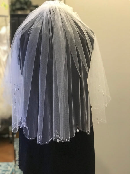 White elbow length double tier wedding veil