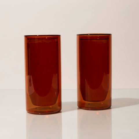 The Amber-colored double-wall 16 oz glasses by Yield