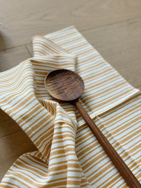 The Table for Two Bundle - Sunset Goldenrod Napkins by Heather Taylor Home and Walnut Cooking Spoon by Four Leaf Wood Shop | H. SMITH
