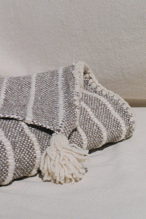 Grey/Cream Rayas Lana Queen Blanket with Pom Poms by Mexchic | H. SMITH