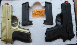 P618GB. Two P618 Pistol, one black, one gold, in a Hard Plastic Case