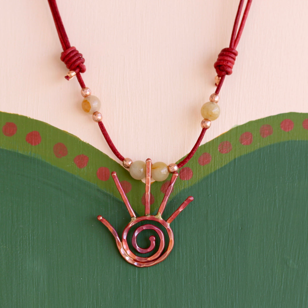 Hand with Spiral Necklace