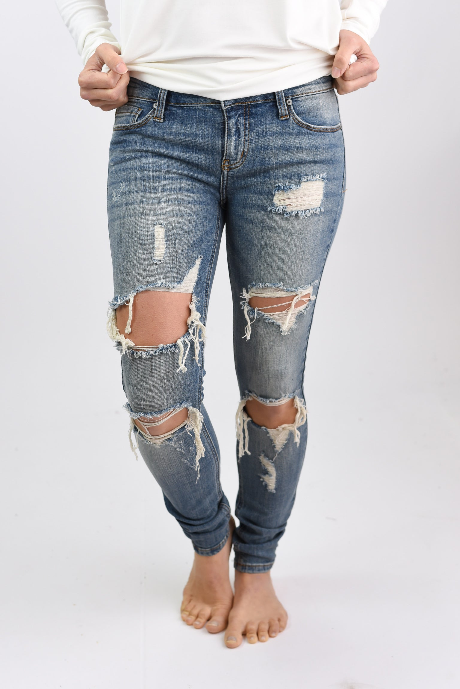 Unmistakable Distressed Low Rise Ankle Skinny Jeans