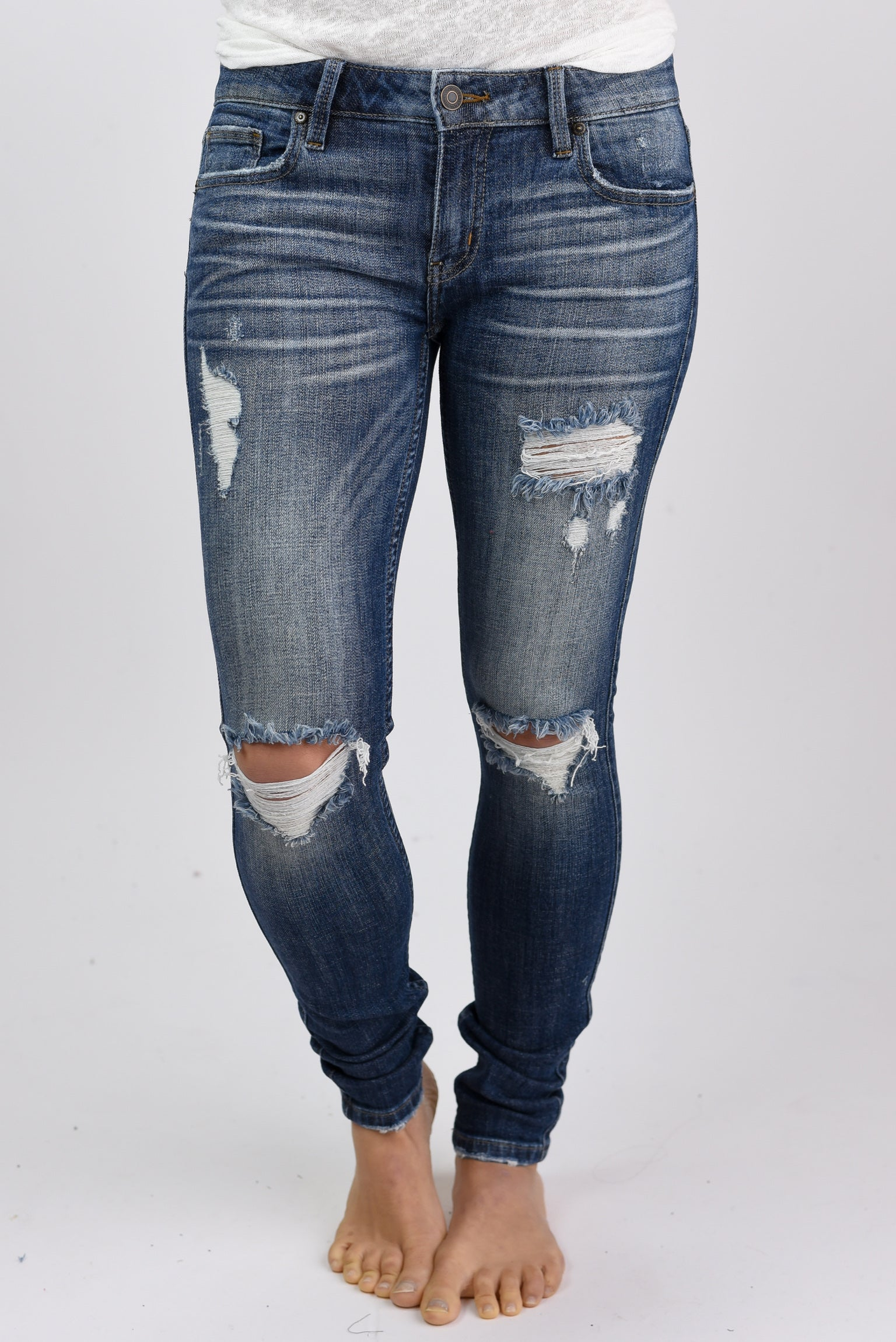 Balancing Act Distressed Low Rise Skinny Jeans