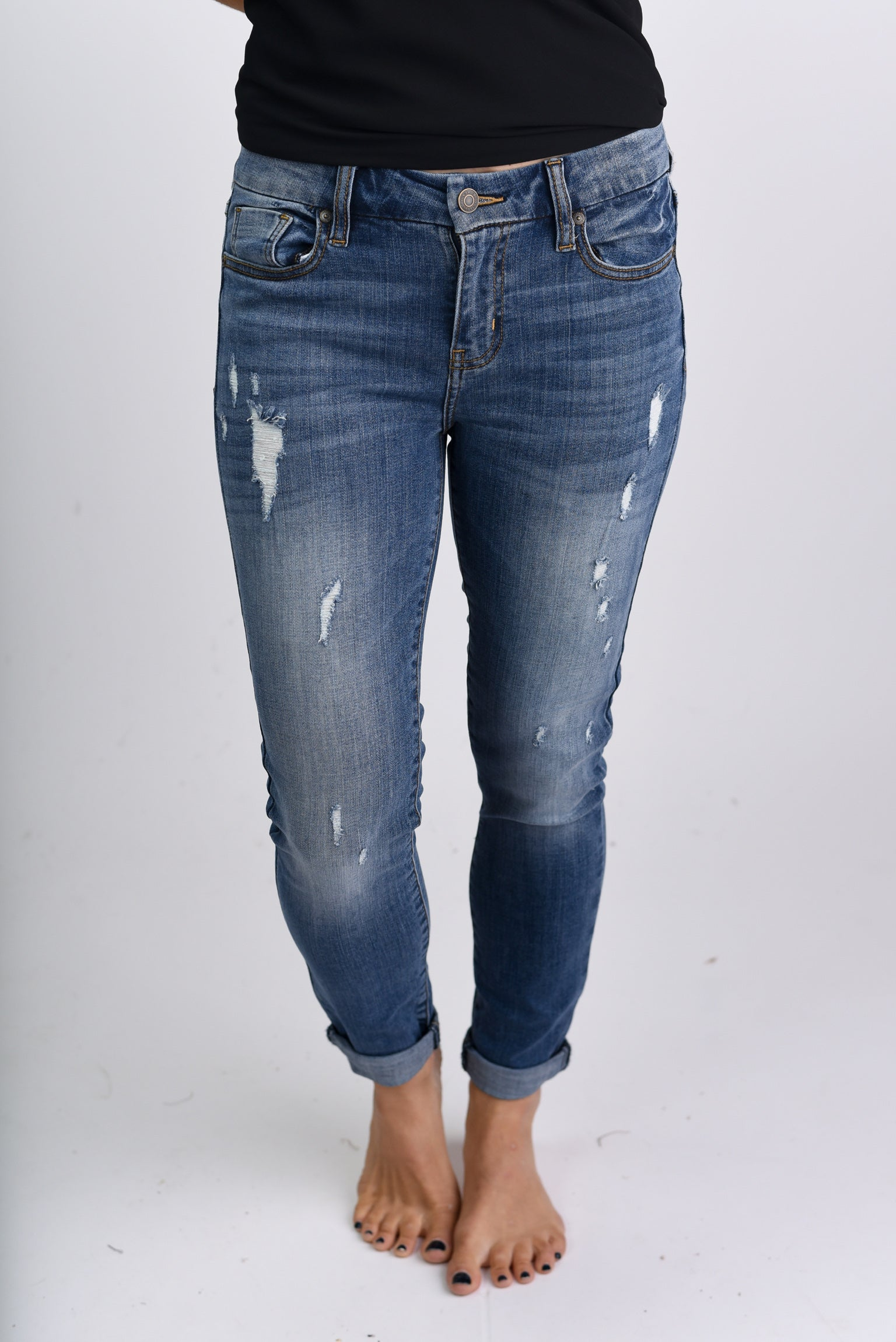 Homebound Mid Rise Distressed Skinny Jeans