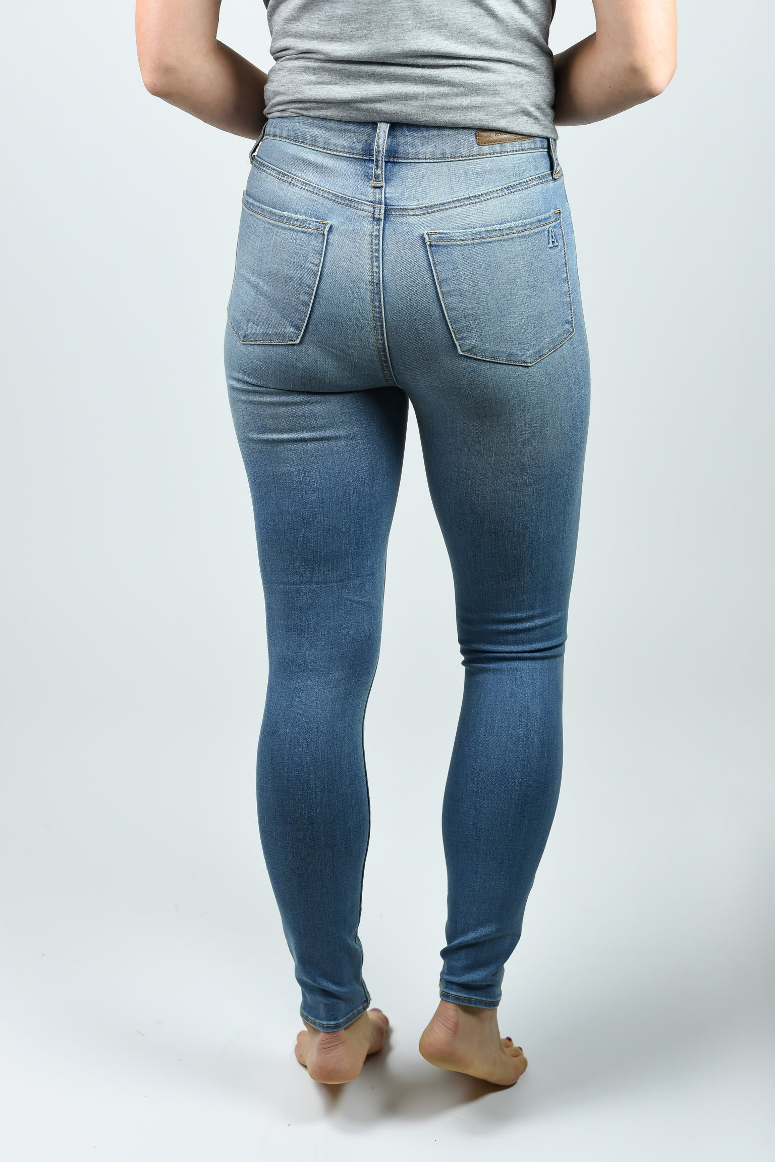 Running Around High Rise Skinny Jeans